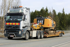 Volvo FH16 Semi Transports Cat Heavy Equipment royalty free stock photography