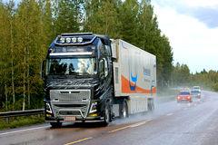 Volvo FH16 Semi Transports MRI Unit along Rainy Road royalty free stock photography