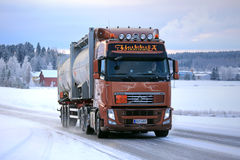 Volvo FH Tanker Truck on Snowy Road. SALO, FINLAND - JANUARY 16, 2016: Volvo FH silo transport truck moves along icy and snowy road in South of Finland in winter Royalty Free Stock Image