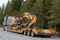 Volvo FH16 transports Cat Tracked Excavator on Trailer Royalty Free Stock Images