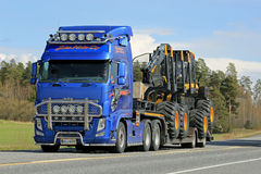 Volvo FH Truck Hauls Ponsse Forest Harvester stock photos