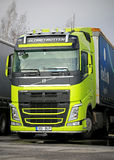 Volvo FH Truck in Highly Visible Lime Green. TURKU, FINLAND - MARCH 8, 2015: Volvo FH truck in a highly visible lime green color. Volvos vision for safety is Royalty Free Stock Photo