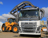 Volvo FH16 750 Truck and Wheel Loader with Log Grapples Stock Photo
