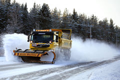 Volvo FM Truck with Snow Plow Clears Winter Road Royalty Free Stock Images