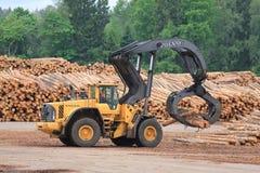 Volvo L180F HL Log Loader Handling Logs Royalty Free Stock Photography