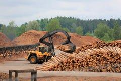 Volvo L180F HL Log Loader Working at Lumber Yard. KYRO, FINLAND - JUNE 7, 2014: Volvo L180F High Lift wheel loader working at mill lumber yard.  The arm is Stock Images