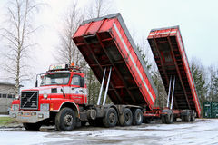 Volvo N12 Truck with Dump Box Trailers Up Stock Image