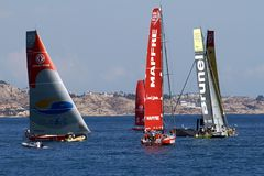 "Volvo Ocean Race sailboats in race. ALICANTE, SPAIN - OCTOBER 04th: Starting the ""In Port Race"" for the Volvo Ocean Race 2014-2015 in Alicante bay. All Volvo Royalty Free Stock Photos"