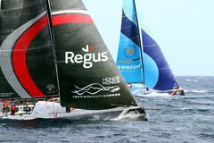 Volvo Ocean Race Team Scallywag and Team Vestas. Team Scallywag and Team Vestas in battle sailing in open waters Royalty Free Stock Images