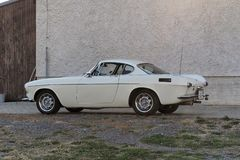 Volvo P1800. The Volvo P1800 is a 2+2, front-engine, rear-drive sports car manufactured and marketed by Volvo Cars between 1961-1973. Originally a coupe 1961 stock photo
