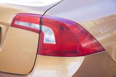 Volvo sedan back light. Beige volvo sedan back light stock photos