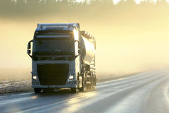 Volvo Semi Tanker Trucking in Sunset Fog royalty free stock images