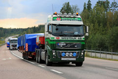 Volvo Semi Truck Wide Load Transport in the Evening Stock Photo