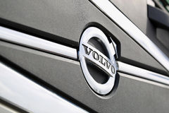 Volvo Symbol Close Up. TURKU, FINLAND - APRIL 19, 2015: Symbol of Volvo in front of a Volvo FH truck. Dual clutch technology for heavy trucks will receive Volvos stock images