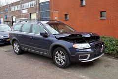 Volvo v70 with damage. Naarden, Gooise Meren, The Netherlands - March 23, 2018: Volvo v70 with damage parked by the side of the road. Nobody in the vehicle Royalty Free Stock Images