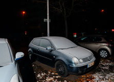 Volvo wagon car covered with snow on the street Stock Photo