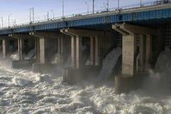 Volzhskaya dam. Water flowing over flood gates of a dam Stock Photos