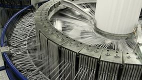 Textile industry - yarn spools on spinning machine in a factory. VOLZHSKY, Russian Federation - OCTOBER 27, 2014: Textile industry - yarn spools on spinning stock video