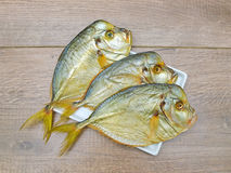 Vomero fish on a plate on a wooden background Stock Photo