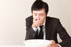 Vomiting businessman Stock Image