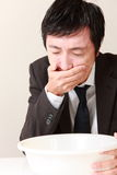 Vomiting businessman Stock Images