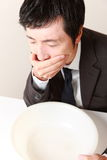 Vomiting businessman Stock Photos