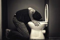Vomito dell'uomo Fotografie Stock