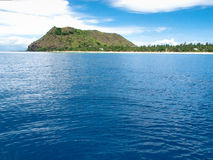 Vomo Island, Fiji. MWS: Tranquil seas surround the tropical Fijianluxury retreat island of Vomo. fringed by  coconut palms and spectacular coral this upmarket Stock Photo