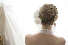 Von hinten die Braut Stockbild