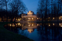Vondel park, Amsterdam. Reflections in the pool of film museum at the Vondel Park Amsterdam: night scenery Stock Images