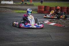 Vont le coureur de kart sur la voie, championnat suisse de kart photographie stock
