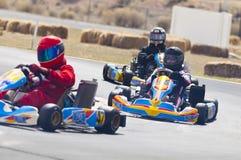 Vont les coureurs de kart Photo libre de droits