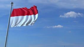 Voo comercial do avião acima da bandeira de ondulação de Indonésia filme