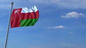 Voo comercial do avião acima da bandeira de ondulação de Omã filme
