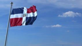 Voo comercial do avião acima da bandeira de ondulação da República Dominicana filme