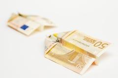 Voo do dinheiro, aviões de papel Foto de Stock