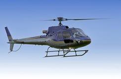 Voo do helicóptero na missão fotografia de stock royalty free