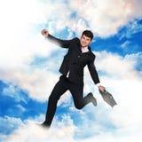 Voo do homem de negócios no céu Fotografia de Stock Royalty Free