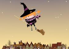 Voo pequeno da bruxa em uma vassoura Imagens de Stock