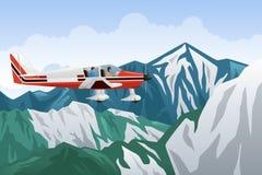Voo pequeno do avião através das montanhas Imagem de Stock