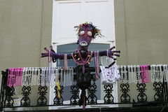 Voodoo Doll and Beads. Decorations for Mardi Gras in the French Quarter in New Orleans, LA Royalty Free Stock Image