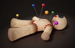Voodoo doll with needles  on black background.  Royalty Free Stock Photography