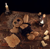 Voodoo doll in pentagram circle on wooden planks. Halloween background, black magic rite or spell with evil candles, occult and esoteric symbols on witch table royalty free stock photography