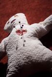 Voodoo Doll with Pins in its Heart. White Voodoo Doll with Pins in its Heart on Red Background Royalty Free Stock Photos
