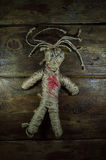 Voodoo Doll. On wooden background Stock Photo