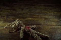 Voodoo Doll. On wooden background Royalty Free Stock Images
