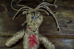 Voodoo Doll. On wooden background Royalty Free Stock Photos