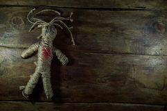Voodoo Doll. On wooden background Royalty Free Stock Image