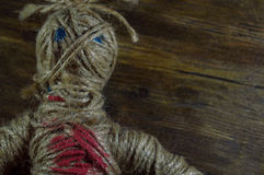 Voodoo Doll. On wooden background Stock Images