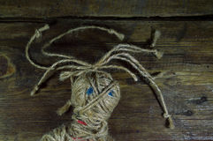 Voodoo Doll. On wooden background Royalty Free Stock Photography